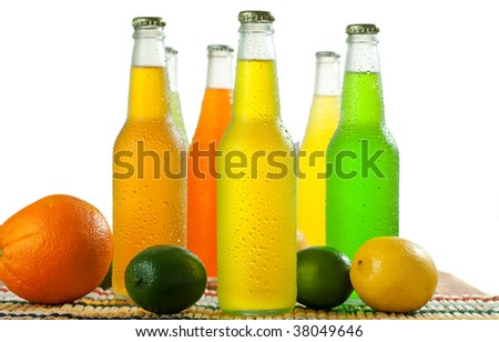 A lot of bottles with tropical drinks on white background