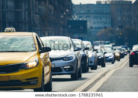 A lot of cars standing in a queue in city center Сток-фото ©