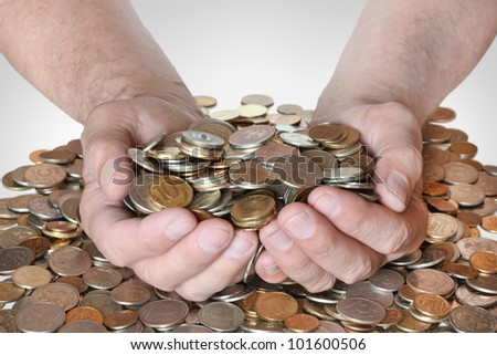 a lot of coins in the hands of men, symbolizing wealth