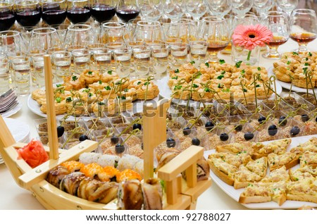 a lot of cold snacks and drinks on buffet table, catering