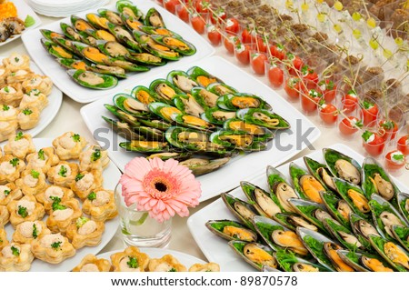 a lot of cold snacks on buffet table, catering, shallow DOF