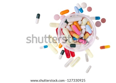 A lot of colored pills and tablets over a white background