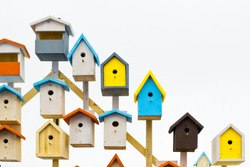 A lot of colorful birdhouses. Life in the neighborhood. Nesting season.