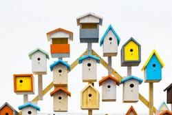 A lot of colorful birdhouses. Life in the neighborhood. Nesting season.