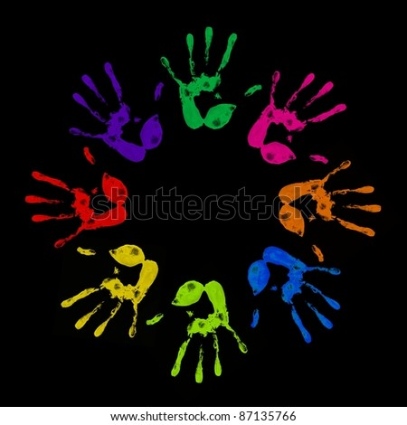 a lot of colorful hand prints on black background