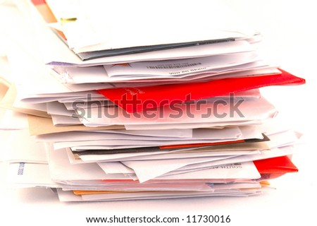 A lot of colorful letters and junk mail on a table isolated on white background - stock photo