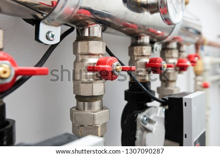 A lot of different faucets and other equipment for boiling room