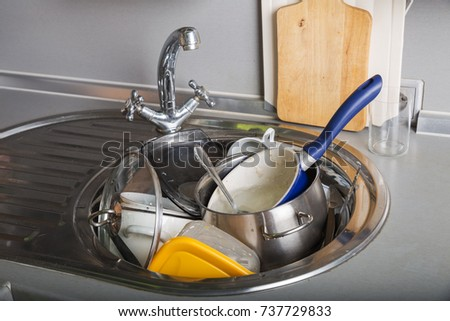 A lot of dirty dishes in the kitchen sink | EZ Canvas