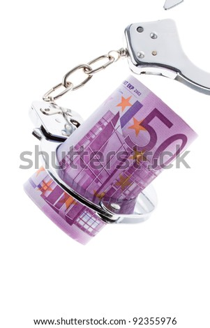 a lot of  euro bank notes with handcuffs