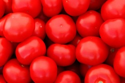 a lot of fresh red tomatoes background vegetables