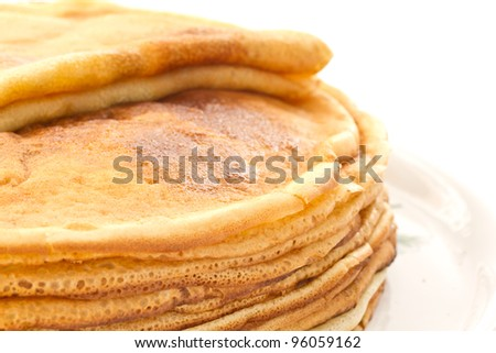 a lot of fried Pancakes on a plate on a white background - stock photo