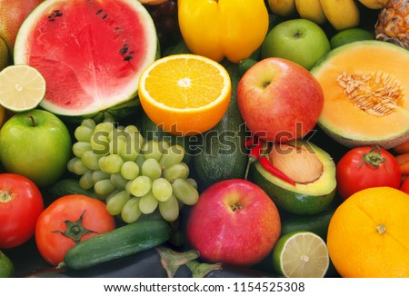 A lot of fruits and vegetables mixed, friuts and vegetables background
