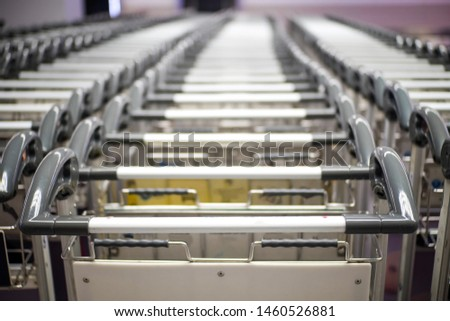 A lot of handle of luggage cart at the airport. #1460526881