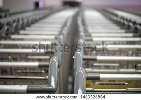 A lot of handle of luggage cart at the airport. #1460526884