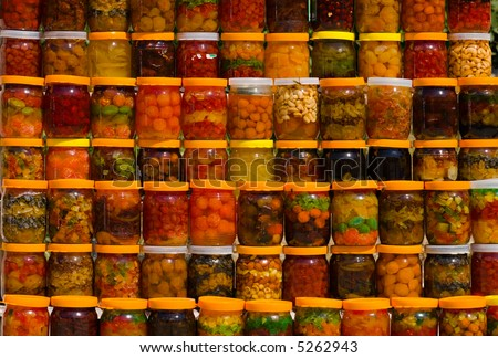 a lot of jars with assorted canned fruits