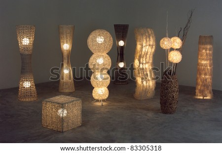A lot of lighten floor  lamps which made of rattan, bamboo and dried water hyacinth in the dark room