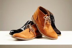 a lot of men's shoes.fashion still life men boots.