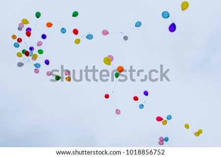 A lot of multi-colored balloons into the sky. Colorful flying balloons. Stok fotoğraf ©