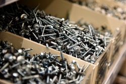 a lot of nails and screws in boxes. tools for repair. men's business. building. hobby . Selective focus