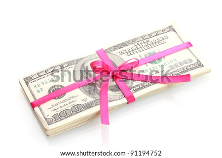 A lot of one hundred dollar bills tied pink ribbon isolated on white