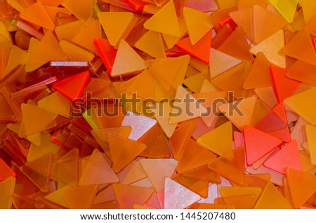 A lot of orange plastic triangles background. Orange and yellow