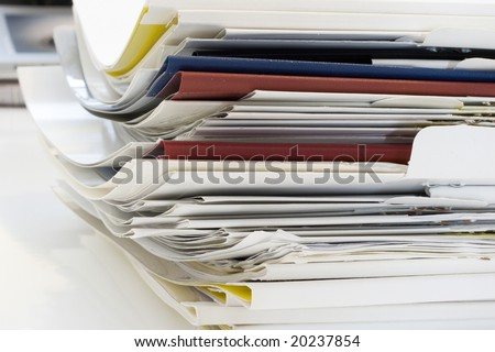 a lot of papers. office scene.