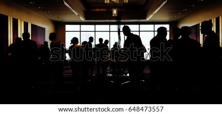 A lot of people are eating while braking in Silhouette. - Shutterstock ID 648473557