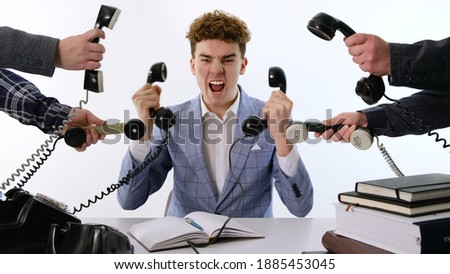 A lot of phone calls: Busy Angry assistant agent helper  working and answering a lot of calls at the same time, landline rotary phone. old school marketing or bad assistance concept Stockfoto ©