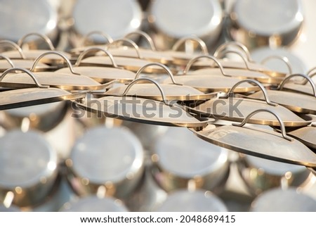 a lot of pot lids as a backdrop in the sunlight, a pot lid, kitchen utensils Photo stock ©