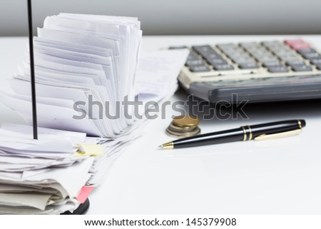A lot of receipts on accountant desk