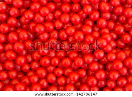 A lot of red candies for background