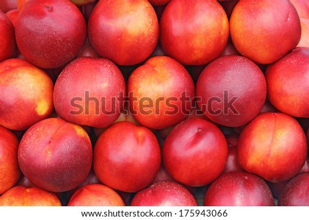 A lot of ripe and juicy nectarines at the market