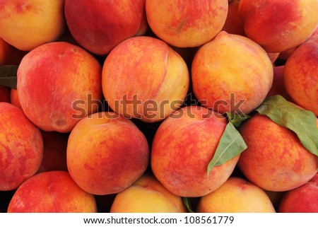 A lot of ripe and juicy peaches at the market - stock photo