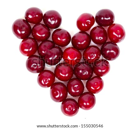 A lot of ripe cherries heart shaped isolated on white background