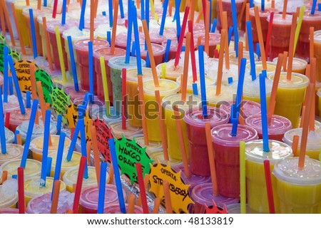 A lot of smoothies with straws