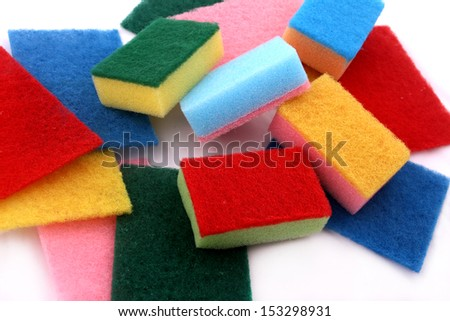 A lot of sponges in different colors background