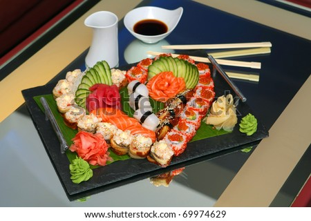 a lot of sushi rolls, a heart-shaped - stock photo