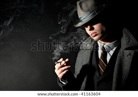 A lot of tobacco smoke exhaled by man in a stylish retro costume