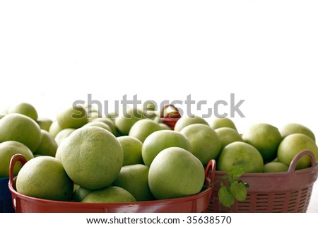 A lot of tropical fruits - Pomello in baskets (isolated on white background)