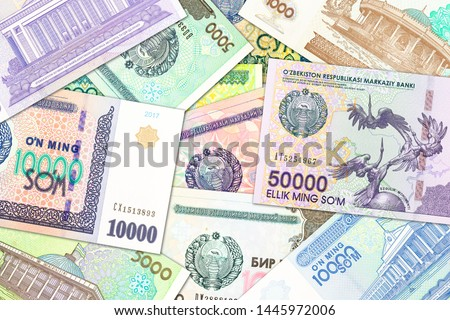a lot of Uzbek Som banknotes indicating growing economy #1445972006