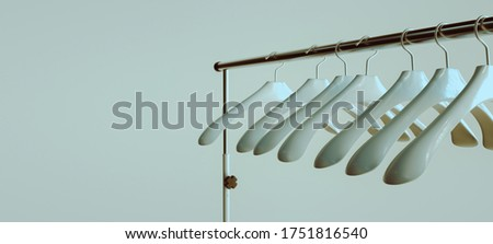 A Lot of White Plastic Hangers on the Empty Coat Rack, 3d Rendering Foto d'archivio ©