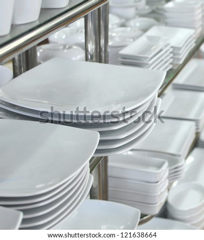 a lot of white plates in a shop