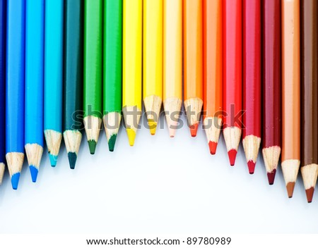 A lot of wooden pencils on a light background
