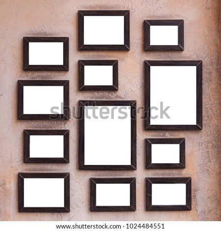 A Lot Of Wooden Picture And Photo Frames Stick On Vintage Wall For