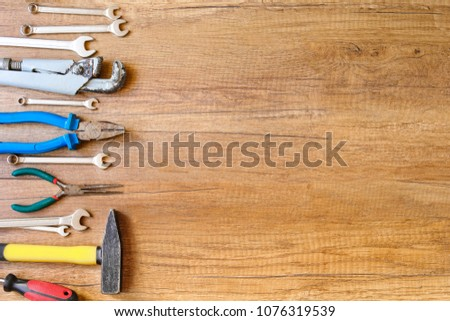 A lot of wrenches. The working set of wrenches on wooden background. Tooling. #1076319539