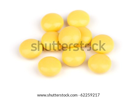 a lot of yellow pill isolated on a white background