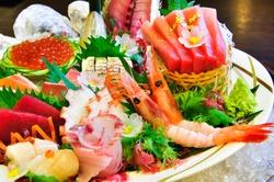 A lot seafood sashimi luxury raw food Japanese style on ice.