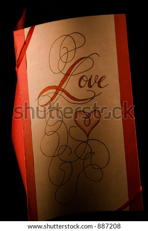 "A love card with ""love"" written on the front with curvy lines and a heart"