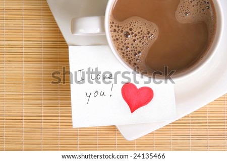 a love note with a cup of coffee on the table