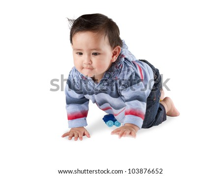 A lovely baby boy crawling on white background